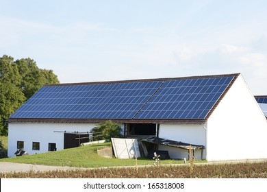 Barn of a farm with solar panels on the roof