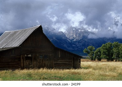 barn with mountain backdrop