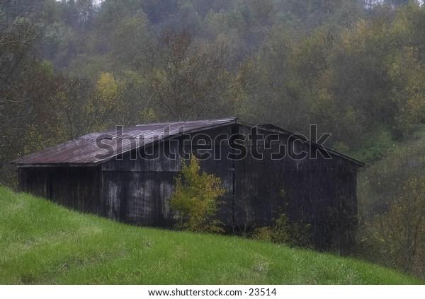 A barn on a rainy, fall day.