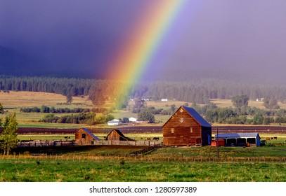 Barn and rainbow on a farm near Enterprize, Oregon