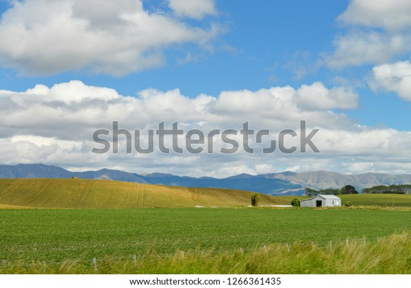 Barn surrounded by mountains, North Otago, New Zealand.