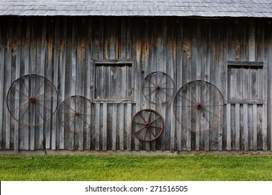barn wall with hanging wagon wheels background