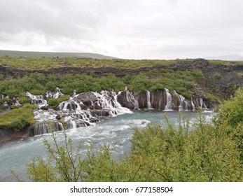 Barnafossar and Hraunfossar in western Iceland on a rainy summer day