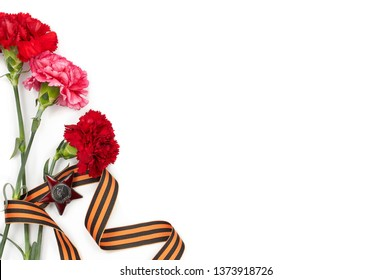 Barnaul, Russia - April 15, 2018: concept background of May 9 russian holiday Victory Day. Red carnations, St. George's ribbon and order of the Red Star. Isolated on white background