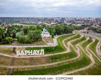 Barnaul, Russia. Description in Russian of Barnaul at the entrance to the city. Highland Park and a new embankment is the top view in summer