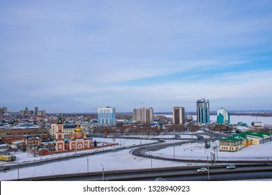 Barnaul / Russia - Feb 2019: The aerial view of frozen Ob river and new buildings in Barnaul. Russian winter in Siberia.