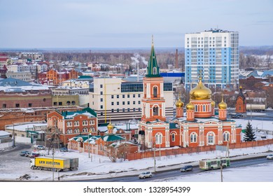 Barnaul / Russia - Feb 2019: The aerial view of Orthodox Church and new buildings in frozen downtown of Barnaul. Russian winter in Siberia.