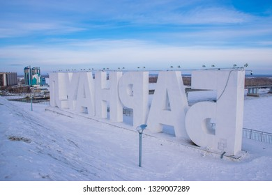 Barnaul / Russia - Feb 2019: The aerial view of frozen Ob river and Barnaul city mane sign on the hill. Russian winter in Siberia.