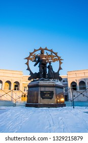 Barnaul / Russia - Feb 2019: A monument to the settlers in the Altai on October square of in Barnaul downtown. Russian winter in Siberia.