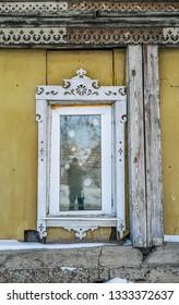 Barnaul / Russia - Feb 2019: The old wooden appartment house in Barnaul. Russian winter in Altai region, Siberia.