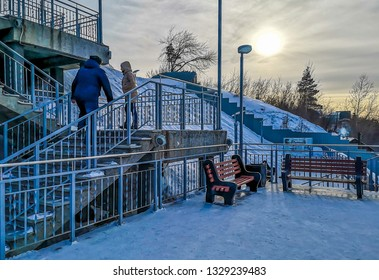 Barnaul / Russia - Feb 2019: The stairs and branches in Highland Park near frozen downtown of Barnaul. Russian winter in Siberia.