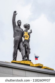 BARNAUL, RUSSIA - JULY, 15, 2017: Sculpture of a man with a raised hand and a woman with a golden lyre on the roof of the Drama Theater in Barnaul city, Russia