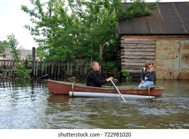 BARNAUL, RUSSIA - JUNE 26, 2010: Locals move around the streets by boat. The Ob river, which came out of the banks, flooded the outskirts of the city.