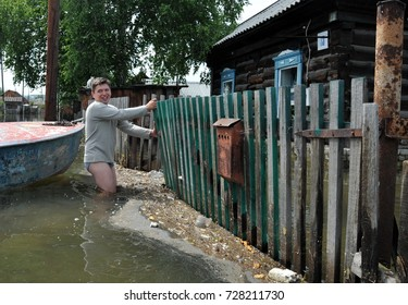 BARNAUL, RUSSIA - JUNE 26, 2010: Local residents move around the streets during a flood. The Ob river, which came over the banks, flooded the outskirts of the city.