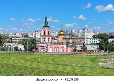 Barnaul, Russia. Znamensky Cathedral (Church of the icon of Our Lady of the Sign) on the background of the central part of the city.