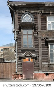 BARNAUL, RUSSIAN FEDERATION - APRIL 30, 2018: Wooden house with carved windows in Barnaul city (Russia). Russian style in architecture