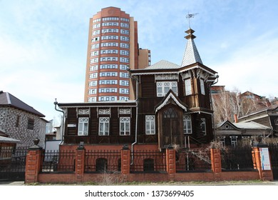 BARNAUL, RUSSIAN FEDERATION - APRIL 30, 2018: Wooden Nosovich's house with carved windows in Barnaul city (Russia). Russian style in architecture