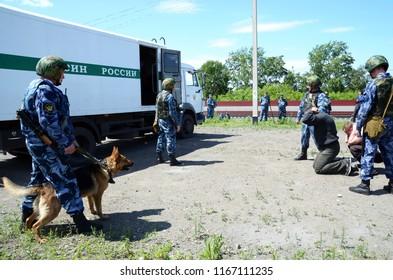 Barnaul,Russia - June 16, 2013.Employees of the penitentiary service escort prisoners