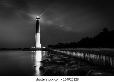 BARNEGAT LIGHT, NJ - JUNE 22: Barnegat lighthouse by night in black and white on June 22, 2013 in Barnegat Light, NJ.