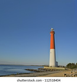 Barnegat Lighthouse also known as Old Barney on Long Beach Island, New Jersey. The 165 foot tall red and white light house tower marks the 40th parallel.