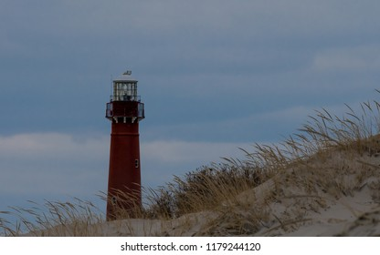 Barnegat Lighthouse viewed through the dunes in Island Beach State Park in Berkeley Township, New Jersey