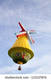 BARNEVELD, THE NETHERLANDS - 17 AUGUST 2012: Colorful wind mill balloon taking off at international balloon festival Ballonfiesta in Barneveld on August 17 2012 in Barneveld, The Netherlands