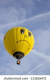 BARNEVELD, THE NETHERLANDS - 17 AUGUST: Colorful yellow balloon with face taking off at international balloon festival Ballonfiesta in Barneveld on August 17, 2012 in Barneveld, The Netherlands