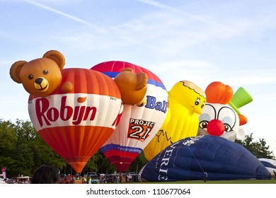 BARNEVELD, THE NETHERLANDS - AUGUST 17: Colorful air balloons taking off at international balloon festival Ballonfiesta on August 17,2012 in Barneveld, The Netherlands