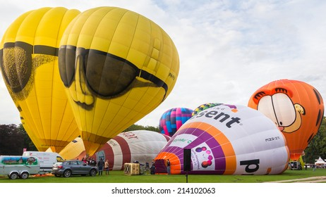 BARNEVELD, THE NETHERLANDS - AUGUST 28: Colorful air balloons taking off at international balloon festival Balloonfiesta on August 28,2014 in Barneveld, The Netherlands