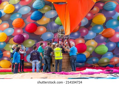 BARNEVELD, THE NETHERLANDS - AUGUST 28: Colorful air balloons taking off at international balloon festival Ballonfiesta on August 28,2014 in Barneveld, The Netherlands