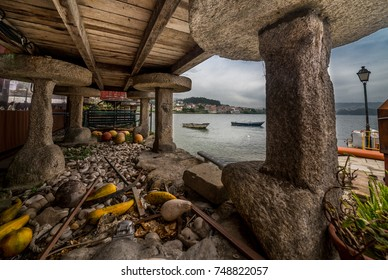 Barns of Combarro village. View to the bay. Galicia