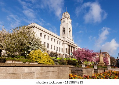 Barnsley Town Hall on a fine spring day, with blue sky and gardens in bloom.