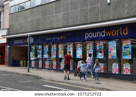 BARNSLEY, UK - JULY 10, 2016: People walk by Poundworld discount store in Barnsley, UK. Poundworld has over 350 stores in the UK.