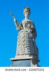 BARNSTAPLE, DEVON, UK - 10/20/2018- Architectural detail of the statue of Queen Anne at Queen Anne's walk in Barnstaple, North Devon, UK
