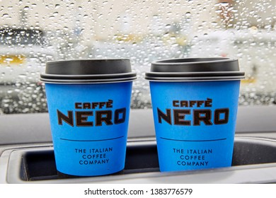 BARNSTAPLE, DEVON UK - APRIL 24TH 2019- 'Caffe Nero' disposable coffee cups on car dashboard during rain