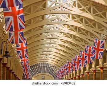BARNSTAPLE, ENGLAND - APRIL 18: Union Jack flags adorn the Victorian pannier market hall in Barnstaple, England on April 18, 2011 in advance of royal wedding celebrations