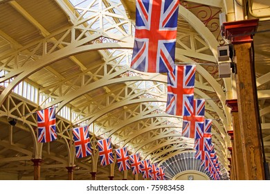 BARNSTAPLE, ENGLAND - APRIL 18: Union Jack flags adorn the Victorian pannier market hall in Barnstaple, England on April 18, 2011 in advance of royal wedding celebrations