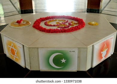 Baroda / Vadodara Gujarat, India -July 25; 2012 : Aum (or OM) is a mantra; or vibration; written on White Marble; Symbol of Different Religions at Dada Bhagwan Samadhi Vadodara