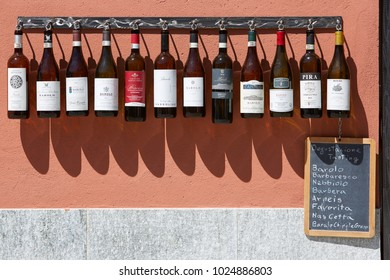 BAROLO, ITALY - AUGUST 6: Piedmont wine bottles collection in front of winery in a sunny summer day on August 6, 2016 in Barolo, Italy.