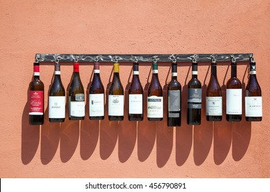 Barolo, Italy - July 9, 2016: Rows of wine bottles hanging on the wall in Barolo, Italy