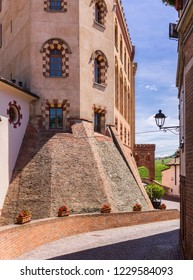 Barolo, Italy - May 24, 2018: Street view with the castle. Barolo is the capital of Langhe (Unesco World Heritage Site), where Barolo wine is produced.