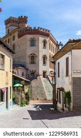 Barolo, Italy - May 24, 2018: Street view in the old town with castle in the background. Barolo is the capital of Langhe (Unesco World Heritage Site), where Barolo wine is produced.