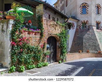 Barolo, Italy - May 24, 2018: Street view in the old town, with the castle in the background. Barolo is the capital of Langhe (Unesco World Heritage Site), where Barolo wine is produced.