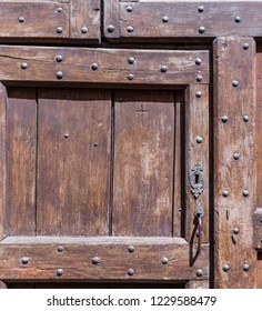Barolo, Italy - May 24, 2018: Old wooden door in the old town. Barolo is the capital of Langhe (Unesco World Heritage Site), where Barolo wine is produced.