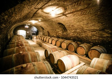 Barolo, Italy - October 2016: Historic wine cellar in Langhe (Piedmont, Italy) with many barriques and slavonian oak barrels for the aging of red wine