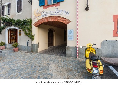 Barolo, Italy - September 25, 2010: Street view with yellow scooter and wine shop. Barolo is the capital of the Langhe (Unesco World Heritage Site), where Barolo wine is produced.