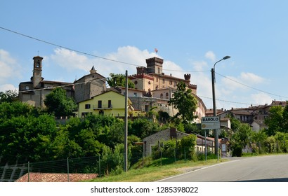 Barolo, province of Cuneo, Piedmont, Italy. July 2018. View on the historical center of Barolo, as it appears on those who cross the road that leads to the historical center. The castle stands out.