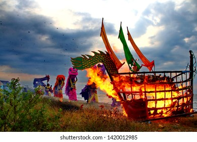 Barongsai and Dragon boat burning. Among Indonesians of Chinese descent, usually held during the Peh Cun Festival, which they will celebrate, Pekalongan/Central Java Indonesia, June 7, 2019