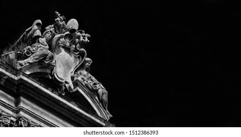 Baroque architecture in Rome. Pope emblem between angels at the top of Ss Luca and Martina Church, designed by Pietro da Cortona in the 17th century (Black and White with copy space)