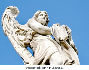 Baroque Bernini angel statue at the Vatican in Rome, Italy on a bright blue sky day.